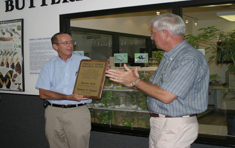 Thomas C. Emmel receives a plaque from Ron Boender